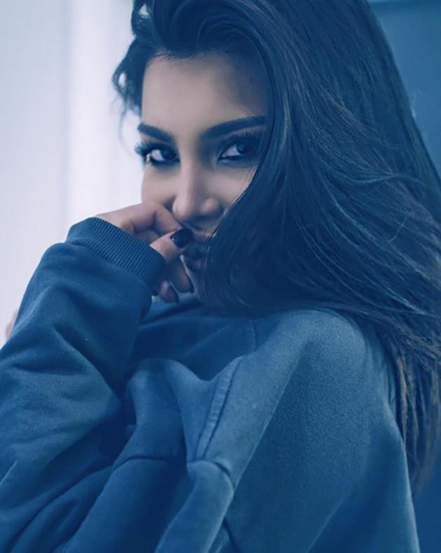 Kamilla Osman Poses Like Kim Kardashian