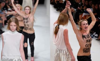Hollie-May Saker OWNS Topless Protester at Paris Fashion Week Show