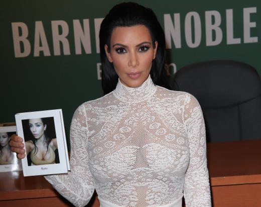 Kim Kardashian with Selfie Book