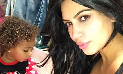 Kim Kardashian Shows Off Cleavage, Cute Daughter