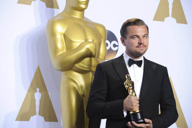 Leonardo DiCaprio Holds His Best Actor Oscar in the Press Room