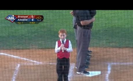 Young Boy Fights Through Hiccups, Completes Inspiring Rendition of National Anthem