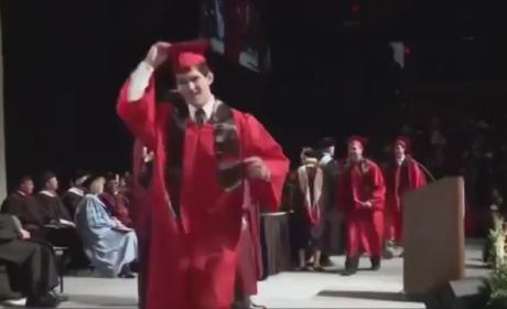 Davenport University Student Backflips at Graduation, Faceplants