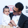 Chris Brown Walks Billboard Music Awards Red Carpet with Royalty!