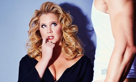 Amy Schumer Flaunts Cleavage, Makes Like Madonna