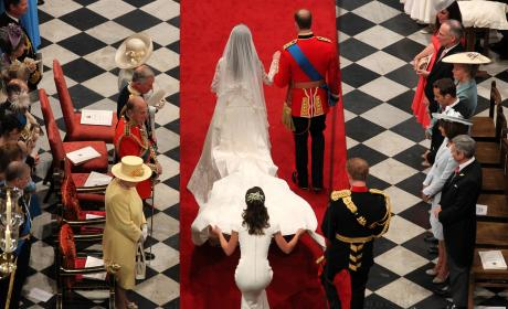 Pippa Middleton Tends To Her Sister's Dress At The Royal Wedding