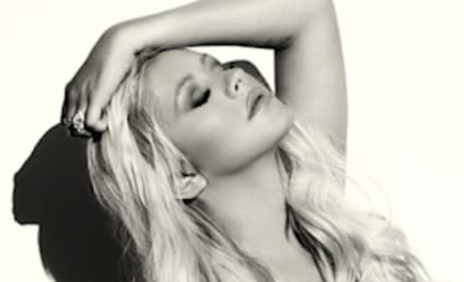 Christina Aguilera Posts Topless Selfie, Sparks Implant Rumors