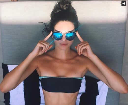 Kendall Jenner Sunbathes
