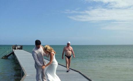 Awesome Dude in Speedo Photobombs Romantic Wedding Portrait