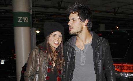 Marie Avgeropoulos and Taylor Lautner