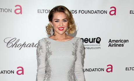 Who looked better at Elton John's Oscars party, Miley or Kim?