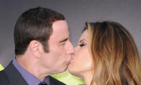 John Travolta, Kelly Preston Kiss at Savages Premiere