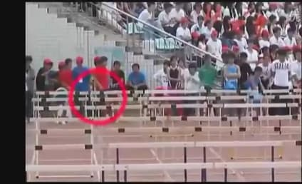 Chinese Hurdler Crashes Through EVERYTHING, Does Not Care