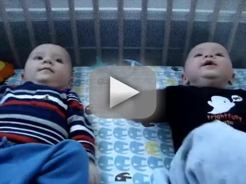 5 month old twins rivet in heated conversation
