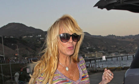 Dina Lohan on the Beach