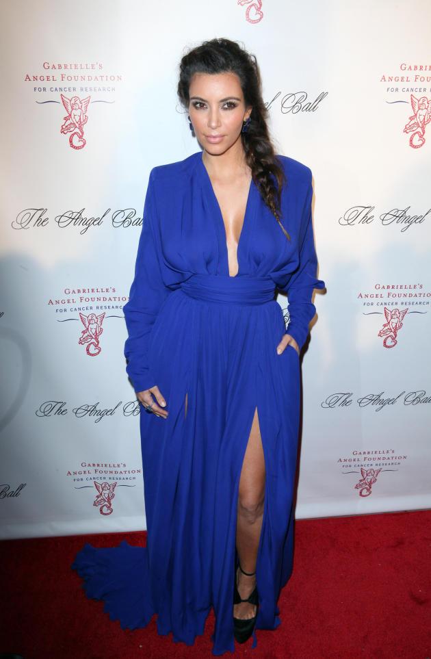 Kim Kardashian Shows Leg