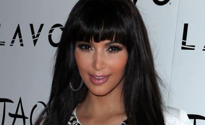 New Year's Eve Fashion Face-Off: Kim Kardashian vs. Fergie