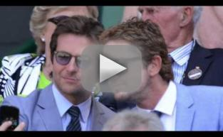 Man in Blue Suit Watches Tennis Match Review
