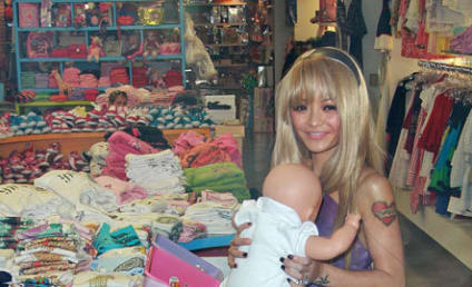 Tila Tequila Poses with Fake Baby, Hints at Fake Father of Fake Child