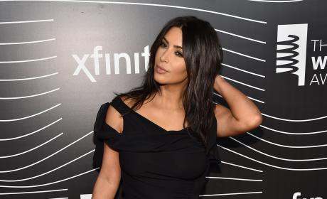 Kim Kardashian Plays with Hair