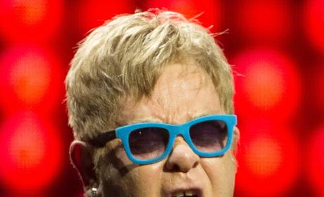 Elton John with mouth open