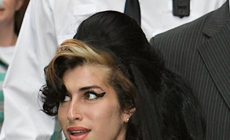 Hair She Is: Amy Winehouse Hangs Out (of Window)