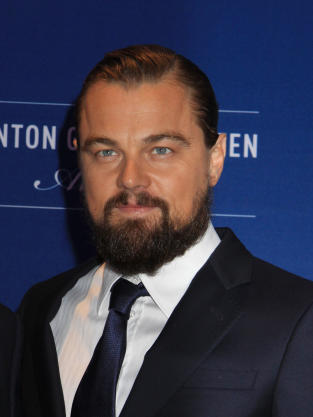 Yes, sources say Cap and RiRi were spotted sucking face during a birthday party for designer Nikki Erwin held at the Playboy Mansion. - leonardo-dicaprio-image