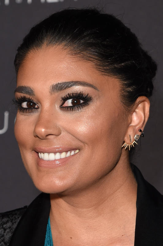 Rachel roy smiling for the camera