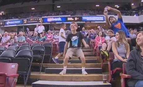 Young Fans Dances Up Happy Storm at Preseason NBA Game