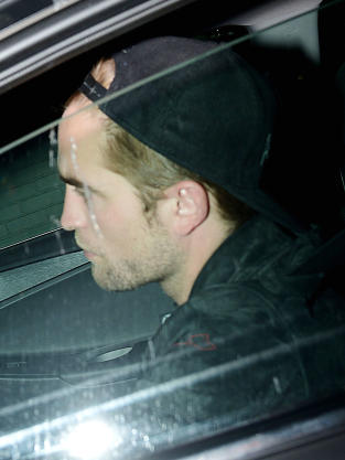 Robert Pattinson in a Car