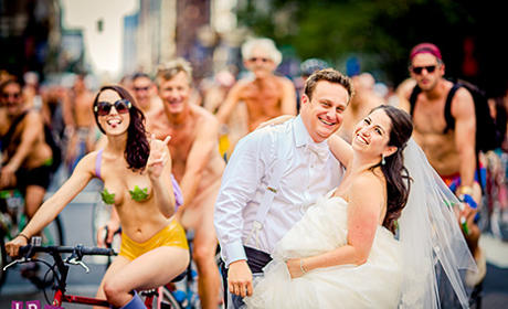 Newlyweds Get Photobomed by Naked Bike Riders