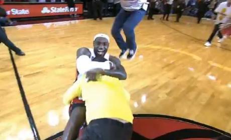 Man Hits Half Court Shot for 75K, Gets Mauled by LeBron James