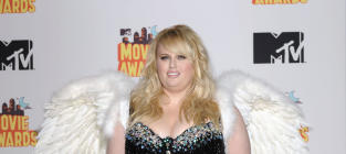 """Rebel Wilson Dons Angel Wins, Tells People to """"THINK"""" at MTV Movie Awards"""