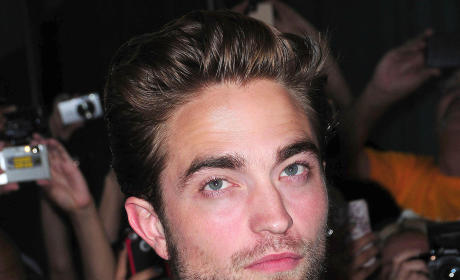 Robert Pattinson Walks Red Carpet of Cosmopolis Premiere