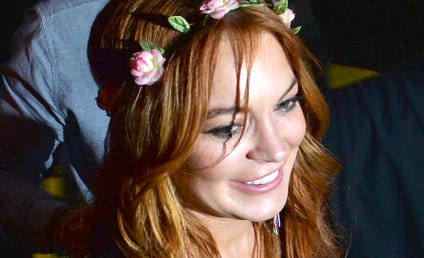 Lindsay Lohan Wardrobe Malfunction Alert: Actress Spills Out of Dress on Liz & Dick Set