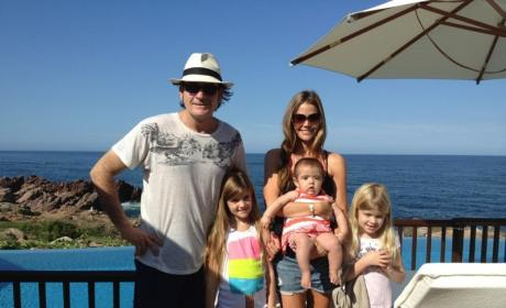 "Charlie Sheen Vacations, Poses for Photo with ""Modern Family"""