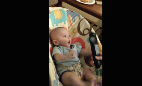 Baby Adorably Flips Out Over Remote, Really Wants to Change the Channel