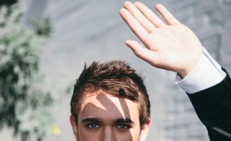 Zedd holding in a bow tie