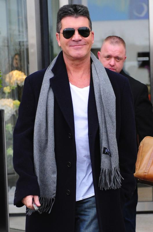 Simon cowell smiles