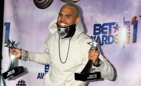 Chris Brown Denies, Threatens Legal Action Over Latest Gay Slur Brouhaha
