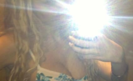 Amanda Bynes Cleavage Photos: Drake, Come Hither!