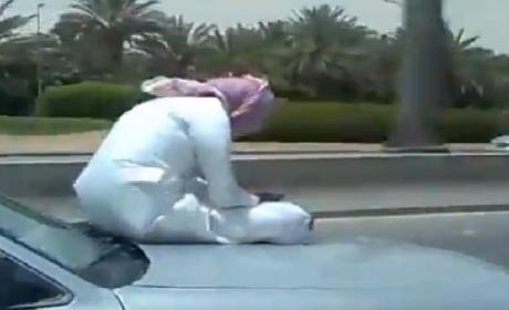 Man Texts on Hood of Speeding Car for Some Reason [Video]