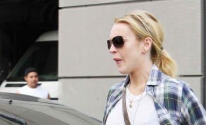 Report: Lindsay Lohan Mauls Gerard Butler