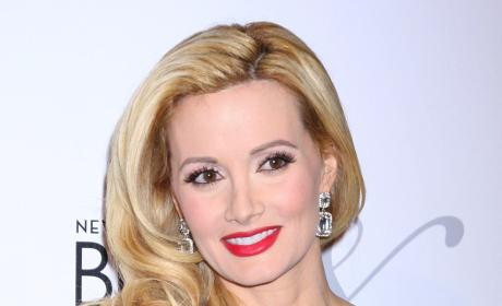 Holly Madison Defends Baby Name, Zings Crystal Harris