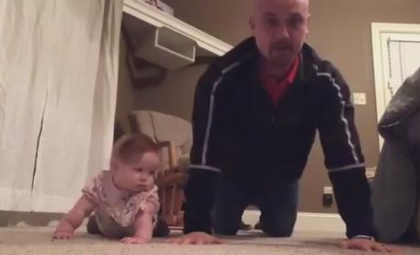 "Baby and Dad Work Out Together in Viral ""Exercise"" Video: Watch in AWW Now!"