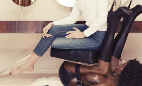Miroslava Duma Sits on Black Woman