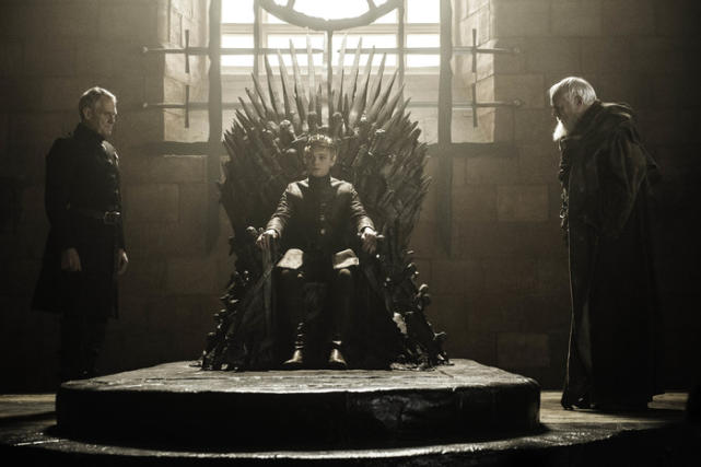 Tommen on the iron throne