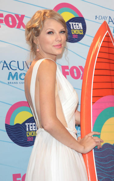 Taylor Swift with a Surfboard