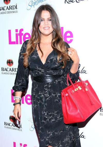 Khloe Kardashian with a Red Purse