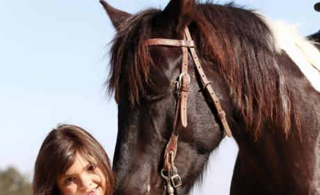 Sophia Abraham Poses With a Horse